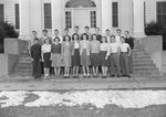 Broadway (High) School, a group of young men and women standing on the front steps.