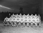 Massanutten Military Academy. Football team seated outdoors