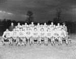 Massanutten Military Academy. Football team seated outdoors
