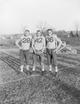 Massanutten Military Academy. Three football players standing on the edge of a field