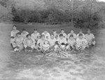 """Team photo of a men's baseball team with the letter """"E"""" on their uniforms"""