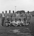 Team photo of an African-American baseball team playing for Elkton, Va., baseball field in the background