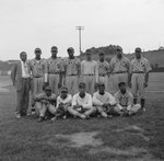 Team photo of an African-America baseball team playing for Elkton, Va., baseball field in background