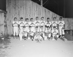 Team photo of the New Market Rebels, baseball team, in front of a fence at the game against the Harrisonburg Turks by William Garber