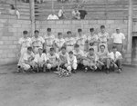 Team photo of the Stanley men's baseball team, with the fan stands in the background