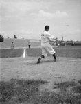 Baseball player swinging at a ball