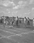 Runners in the starting position to begin a race around an outdoor track