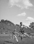 An athlete high jumping over a crossbar