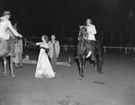 Broadway Horse Show, a woman posing on a horse
