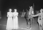 Timberville Horse Show, a man holding a trophy and standing next to his horse, with two finely dressed women standing nearby