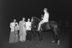 Timberville Horse Show, a man riding a horse with a ribbon and trophy, facing three women