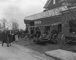 """John Deere Day,"" crowds of people outside of the John Deere Farm Equipment store by William Gaber"