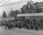 """John Deere Day,"" large crowds of people outside of the John Deere Farm Equipment store by William Gaber"