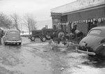"""""""John Deere Day,"""" farm equipment on display outside of the John Deere store"""