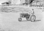 """John Deere Day,"" a woman driving a John Deere tractor by William Gaber"
