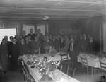 A large group of men wearing suits posing at a banquet of sorts hosted by the Gulf company by William Gaber