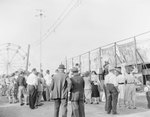 Crowds of people at the Shenandoah County Fair, with a ferris wheel in the background by William Gaber