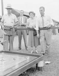 Shenandoah County Fair, a woman and a man playing a game by William Gaber