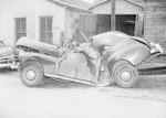 Side view of a severely damaged vehicle by William Garber