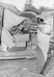 Inside view of a severely damaged vehicle by William Garber