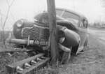 Front view of a vehicle that was forced into a large wooden pole, VA license plate 448-855 by William Garber