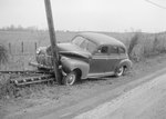 Side view of a vehicle that was forced into a large wooden pole, VA license plate 448-855 by William Garber