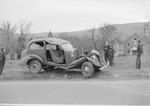 Side view of an automobile with a severely damaged front end, VA license plate 221-062 by William Garber