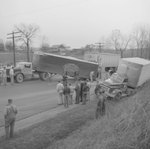 A multi-tractor-trailer accident on a rural road; trucks from Associate Transport and H.P. Welch Co. included