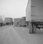 Distant view of a multi-tractor-trailer accident on a rural road