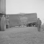 View of a multi-tractor-trailer accident on a rural road with a close up of the H.P. Welch Co. truck