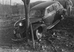 Front diagonal view of an automobile that was driven into a tree