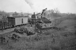 Train wreck, train cars full of logs that had tumbled off of the track by William Garber