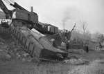 Close up view of the cars full of logs that had steered off the track in the train wreck, which identifies the train to belong to the Baltimore and Ohio Railroad company by William Garber