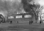 A large building with the second floor on fire by William Garber