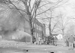 A group of men working to extinguish a large building fire by William Garber