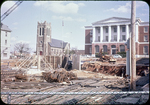 Harrison Plaza under construction Post Office and Catholic Church in background by James Madison University