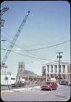 Harrison Plaza under construction, Post Office and Catholic Church in background by James Madison University