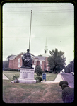 Harrisonburg World War I Monument with Baptist Church (steeple) in background, Sept. '74 by James Madison University