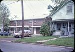 Harrisonburg public housing on E. Gay St. plus neighboring private home by James Madison University