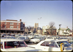 Wolfe St. Parking lot looking toward Post Office and Catholic Church by James Madison University