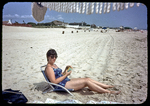 Kathy reading and relaxing on beach